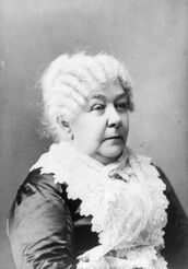 Elizabeth Cady Stanton seated with stern expression