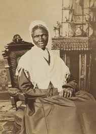 Sojourner Truth seated with knit shawl